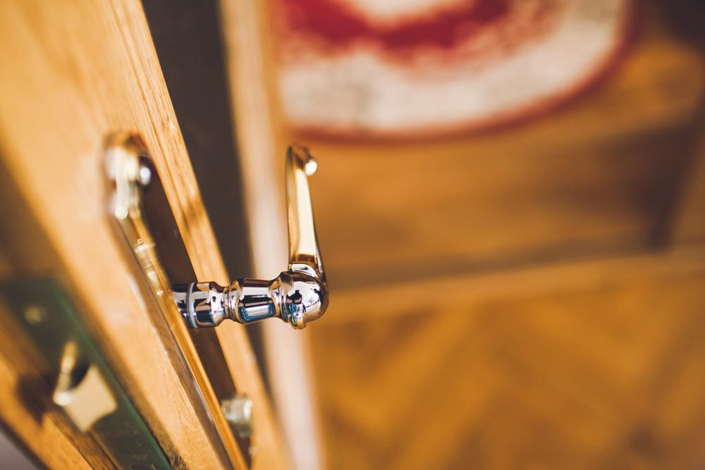 a door handle on a wooden door