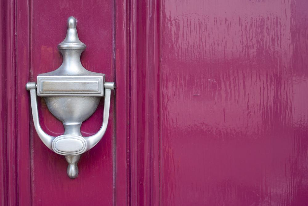 pink door with silver knocker