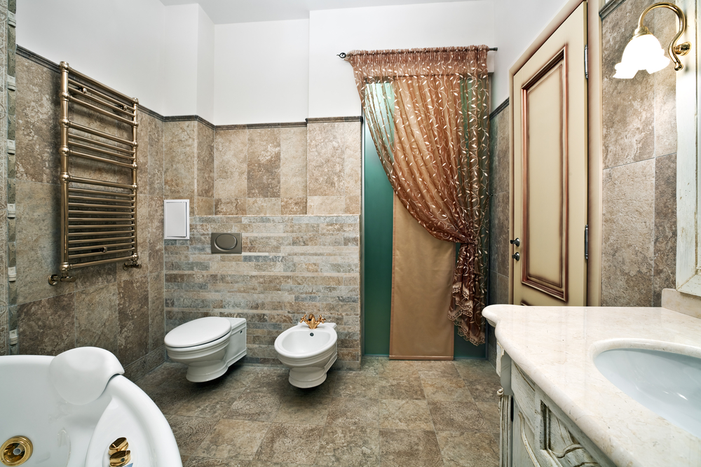 a luxury bathroom using gold metal door and bathroom furniture