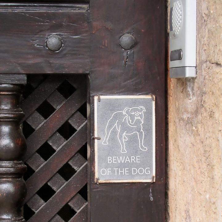 beware of the dog sign on door