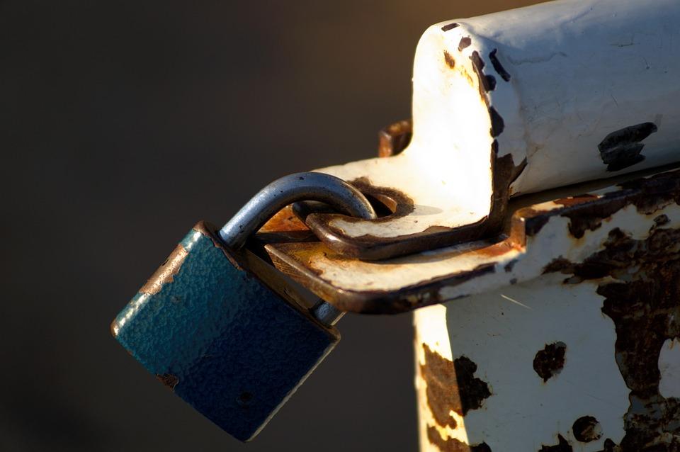 padlock locking a metal gate