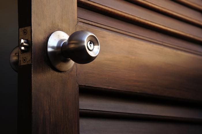 door knob on dark wood door