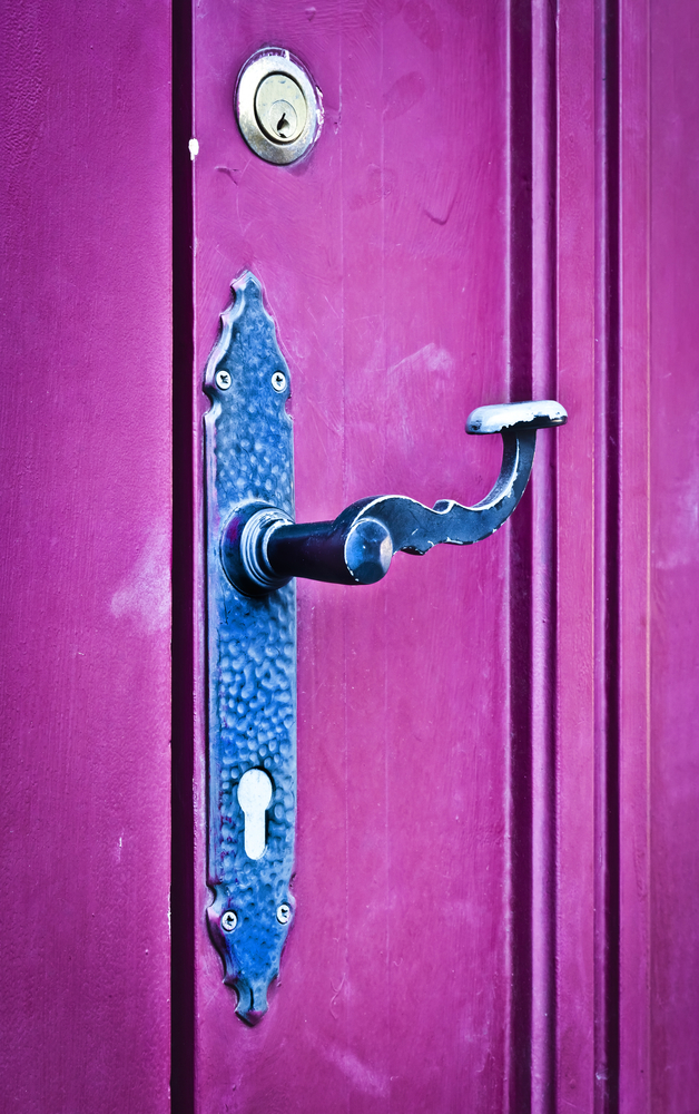 purple door with cast iron door handle