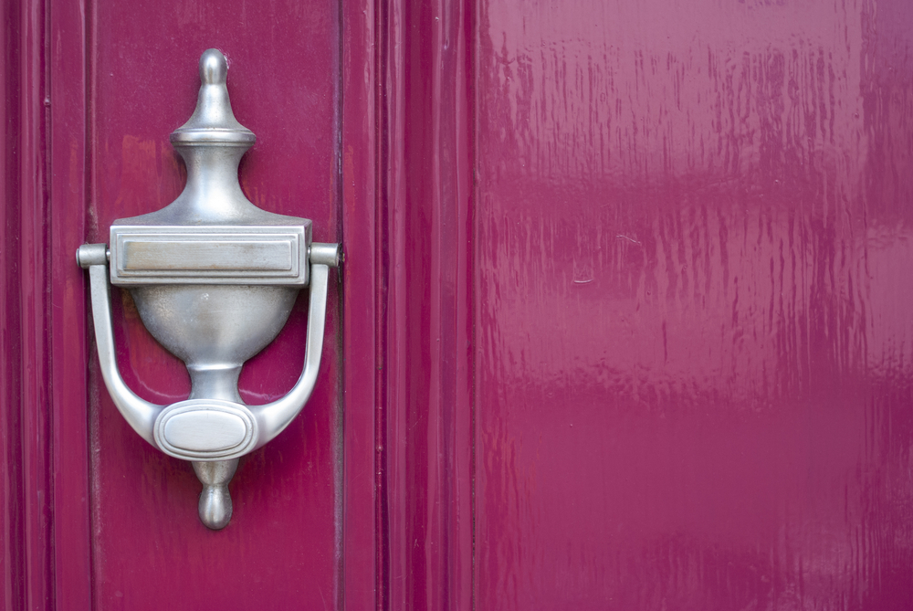 pink door with silver knocker